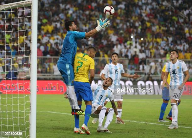 Argentina's goalkeeper Sergio Romero tries to catch the ball during the friendly football match Brazil vs Argentina at the King Abdullah Sport City...