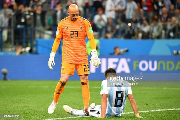 TOPSHOT Argentina's goalkeeper Willy Caballero and Argentina's defender Marcos Acuna react after Croatia scored their third goal during the Russia...