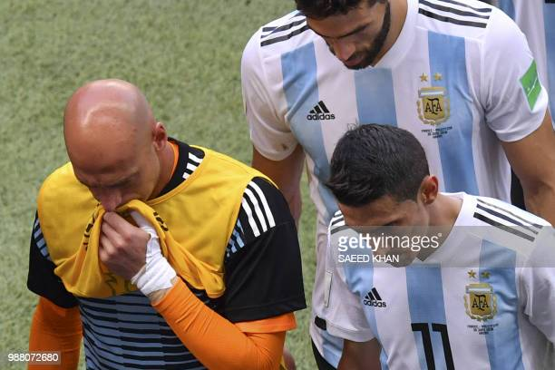 Argentina's goalkeeper Willy Caballero and Argentina's forward Angel Di Maria react after losing the Russia 2018 World Cup round of 16 football match...
