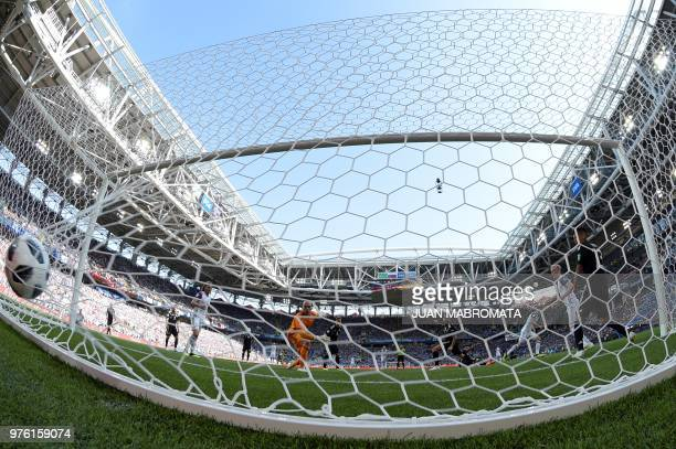 TOPSHOT Argentina's goalkeeper Willy Caballero concedes a goal during the Russia 2018 World Cup Group D football match between Argentina and Iceland...