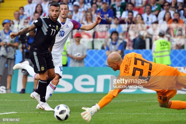 Argentina's goalkeeper Willy Caballero dives to stop the ball during the Russia 2018 World Cup Group D football match between Argentina and Iceland...
