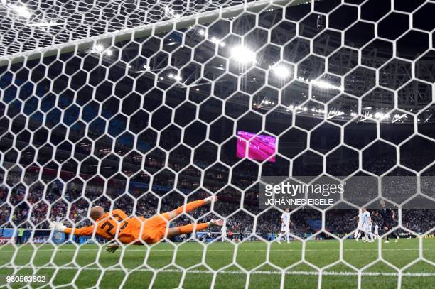 TOPSHOT Argentina's goalkeeper Willy Caballero misses to save a goal by Croatia's midfielder Luka Modric during the Russia 2018 World Cup Group D...