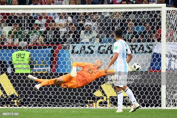 TOPSHOT Argentina's goalkeeper Willy Caballero misses to save Croatia's second goal during the Russia 2018 World Cup Group D football match between...