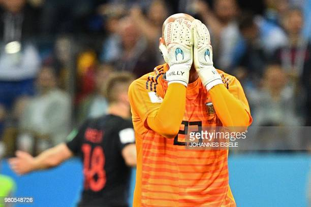 Argentina's goalkeeper Willy Caballero reacts after Croatia scored their opener during the Russia 2018 World Cup Group D football match between...