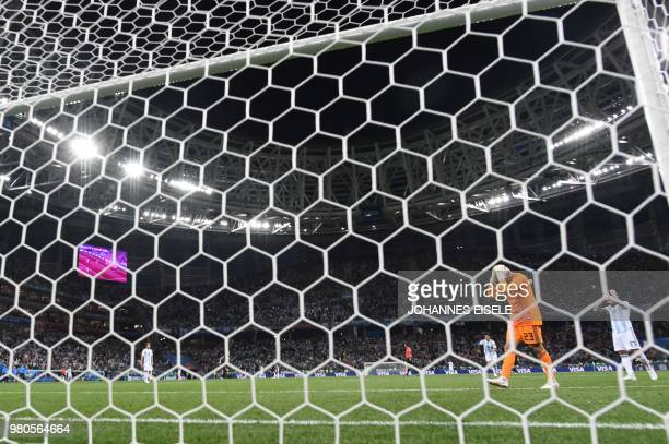 TOPSHOT Argentina's goalkeeper Willy Caballero reacts after Croatia scored their opener during the Russia 2018 World Cup Group D football match...