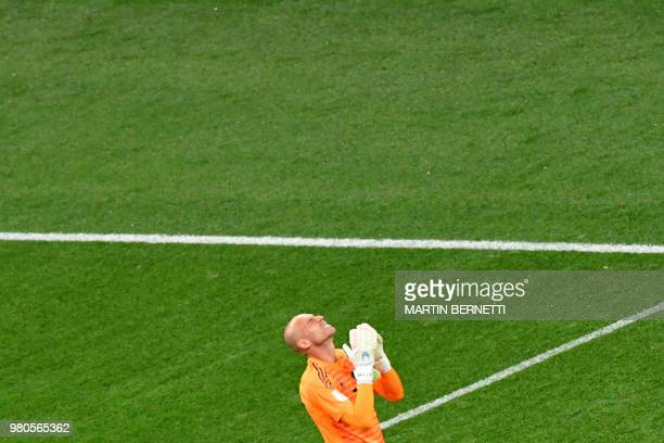 TOPSHOT Argentina's goalkeeper Willy Caballero reacts after Croatia's goal during the Russia 2018 World Cup Group D football match between Argentina...