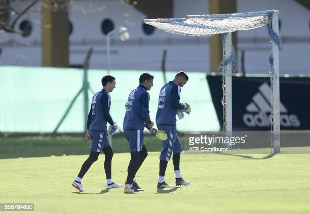 Argentina's goalkeepers Agustin Marchesin Nahuel Guzman and Sergio Romero arrive to a training session in Ezeiza Buenos Aires on October 2 2017 ahead...