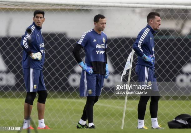 Argentina's goalkeepers Esteban Andrada Agustin Marchesin and Franco Armani a pictured during a training session of the national team in Ezeiza...