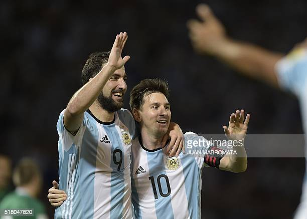 Argentina's Gonzalo Higuain and Lionel Messi celebrate after teammate Gabriel Mercado scored against Bolivia during their Russia 2018 FIFA World Cup...