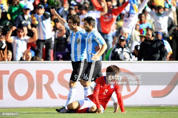 Argentina's Gonzalo Higuain celebrates scoring his sides third goal with teammate Sergio Aguero leaving South Korea's Beom Seok Oh dejected on the...