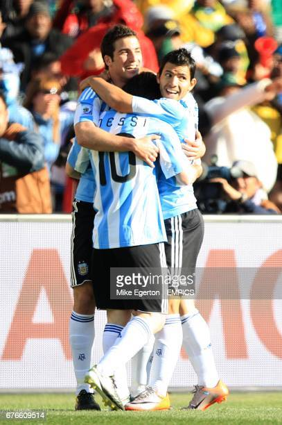 Argentina's Gonzalo Higuain celebrates scoring his sides third goal with teammates Sergio Aguero and Leo Messi
