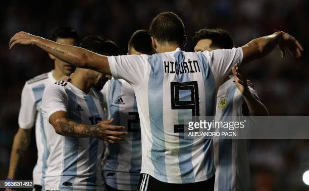 Argentina's Gonzalo Higuain celebrates with Argentina's Lionel Messi and other teammates after Messi scored against Haiti during their international...