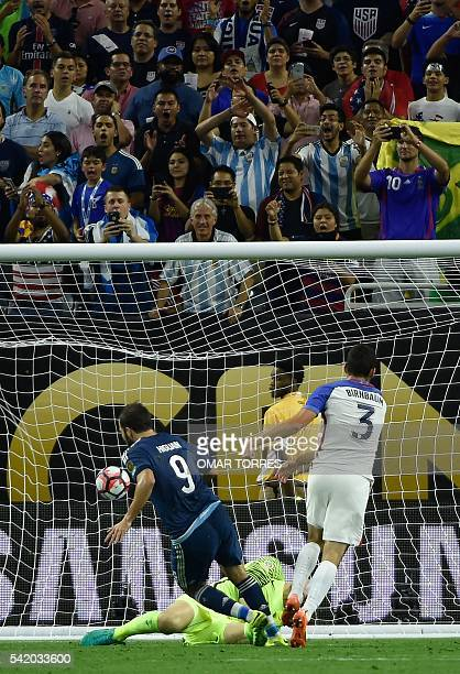 Argentina's Gonzalo Higuain scores past USA's goalkeeper Brad Guzan during their Copa America Centenario semifinal football match in Houston, Texas,...