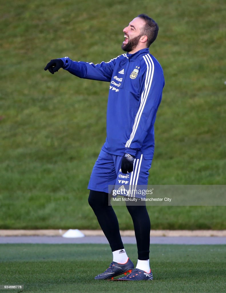Argentina's Gonzalo Higuain smiles during training at Manchester City Football Academy on March 19, 2018 in Manchester, England.