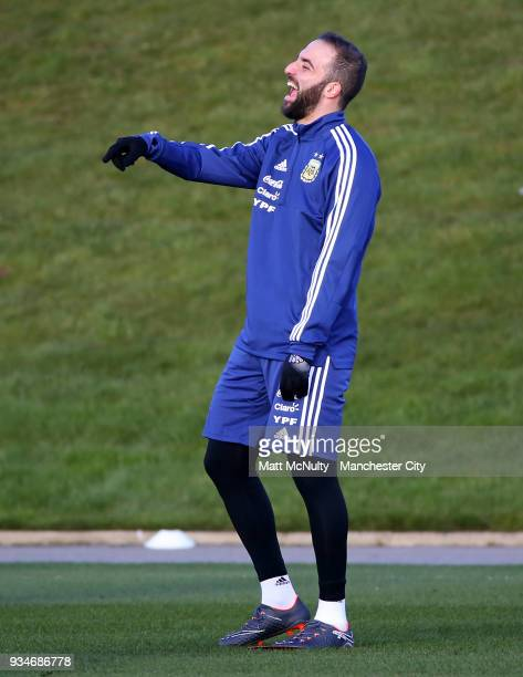 Argentina's Gonzalo Higuain smiles during training at Manchester City Football Academy on March 19 2018 in Manchester England