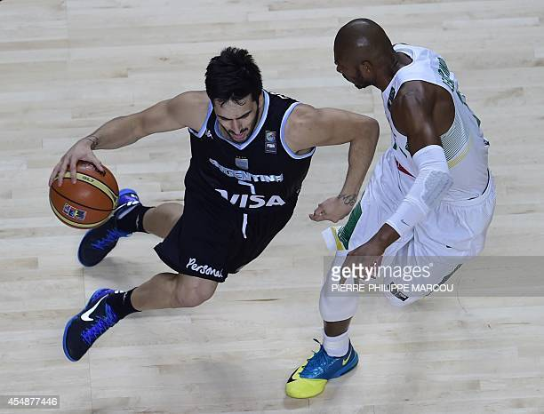 Argentina's guard Facundo Campazzo vies with Brazil's guard Leandrinho Barbosa during the 2014 FIBA World basketball championships round of 16 match...