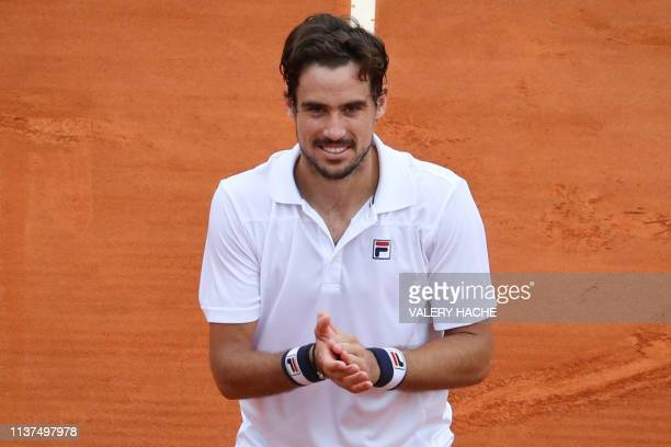 Argentina's Guido Pella celebrates after winning his tennis match against Croatia's Marin Cilic on the day 4 of the MonteCarlo ATP Masters Series...