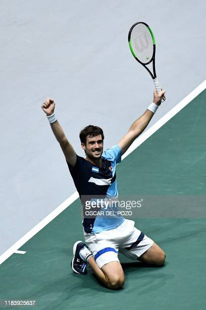 Argentina's Guido Pella celebrates after winning the singles quarterfinal tennis match against Spain's Pablo Carreno at the Davis Cup Madrid Finals...