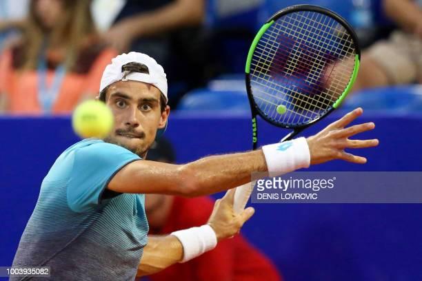 Argentina's Guido Pella hits a return during the Umag 2018 ATP 250 tennis final match between Italia's Marco Cecchinato and Argentina's Guido Pella...