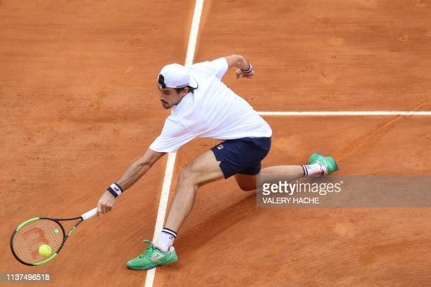 Argentina's Guido Pella plays a backhand return to Croatia's Marin Cilic during their tennis match on the day 4 of the MonteCarlo ATP Masters Series...