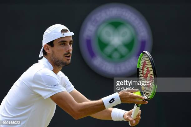 Argentina's Guido Pella prepare to serve to Croatia's Marin Cilic during their men's singles second round match on the fourth day of the 2018...
