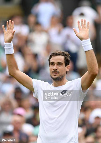 Argentina's Guido Pella reacts after winning against Croatia's Marin Cilic during their men's singles second round match on the fourth day of the...