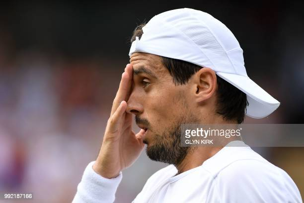 Argentina's Guido Pella reacts against Croatia's Marin Cilic during their men's singles second round match on the fourth day of the 2018 Wimbledon...