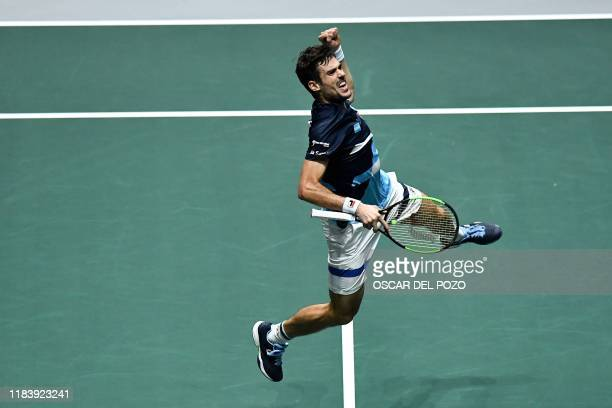 Argentina's Guido Pella reacts during the singles quarter-final tennis match against Spain's Pablo Carreno at the Davis Cup Madrid Finals 2019 in...