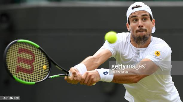 Argentina's Guido Pella returns against Croatia's Marin Cilic during their men's singles second round match on the fourth day of the 2018 Wimbledon...