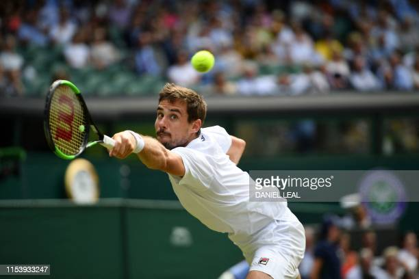 TOPSHOT Argentina's Guido Pella returns against South Africa's Kevin Anderson during their men's singles third round match on the fifth day of the...