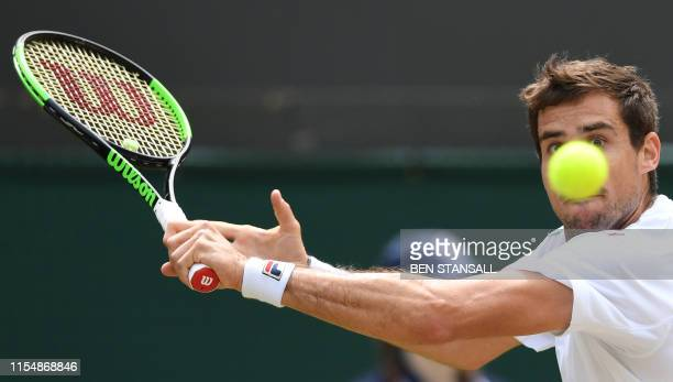 TOPSHOT Argentina's Guido Pella returns against Spain's Roberto Bautista Agut during their men's singles quarterfinal match on day nine of the 2019...