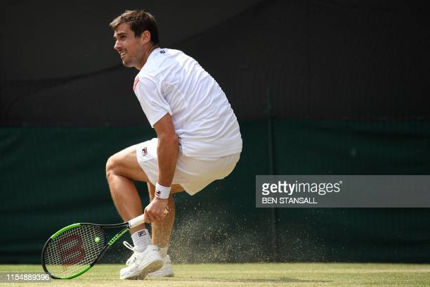 Argentina's Guido Pella returns against Spain's Roberto Bautista Agut during their men's singles quarterfinal match on day nine of the 2019 Wimbledon...