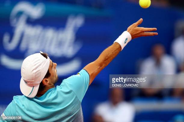Argentina's Guido Pella serves the ball during the Umag 2018 ATP 250 tennis final match between Italia's Marco Cecchinato and Argentina's Guido Pella...