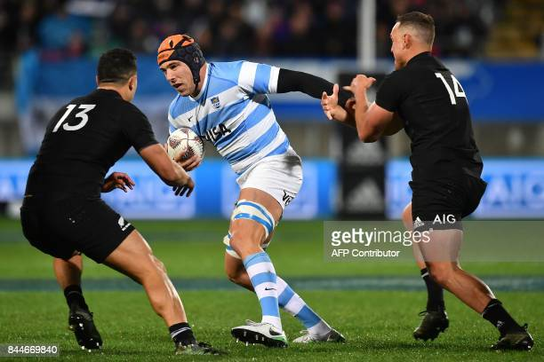 Argentina's Guido Petti is tackled by New Zealand's Anton LienertBrown and Israel Dagg during the Rugby Championship match between the New Zealand...