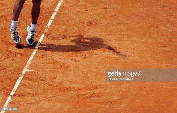 Argentina's Guillermo Canas hits a return against Spain's David Ferrer during their match of the ATP Madrid Masters claycourt tournament on May 11...