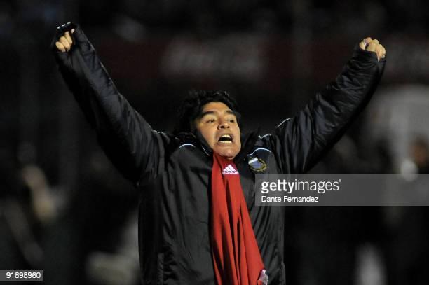 Argentina's head coach Diego Armando Maradona celebrates victory over Uruguay during their 2010 FIFA World Cup qualifier match at the Centenario...