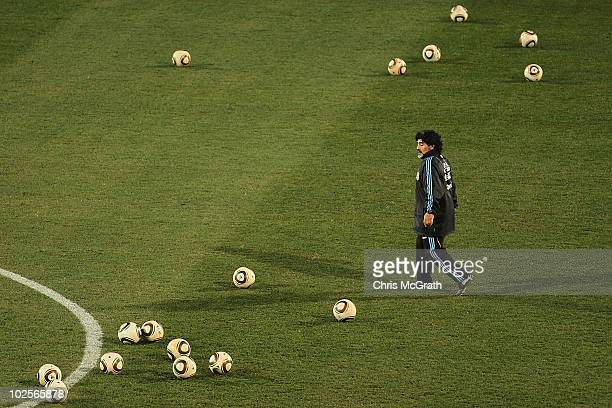 Argentina's head coach Diego Maradona collects balls during a team training session on July 1 2010 in Pretoria South Africa