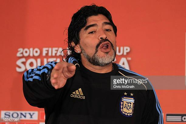 Argentina's head coach Diego Maradona gestures for photographers to leave a press conference at Loftus Versefeld Stadium on June 26 2010 in Pretoria...