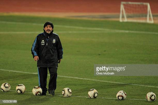 Argentina's head coach Diego Maradona lines up balls for goalkeeper practice during a team training session on June 23 2010 in Pretoria South Africa
