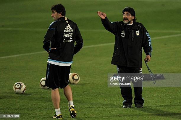 Argentina's head coach Diego Maradona talks with Diego Milito during a team training session on June 9 2010 in Pretoria South Africa