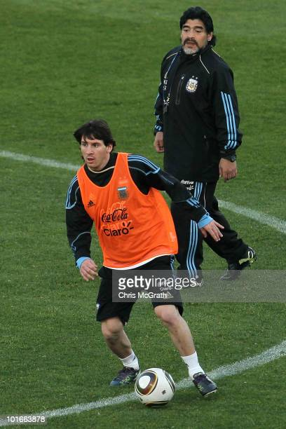 Argentina's head coach Diego Maradona watches on as Lionel Messi looks to pass during a team training session on June 6 2010 in Pretoria South Africa