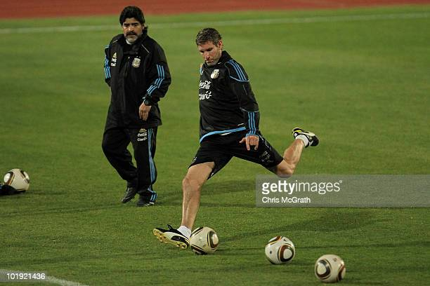 Argentina's head coach Diego Maradona watches on as Martin Palermo takes a shot at goal during a team training session on June 9 2010 in Pretoria...
