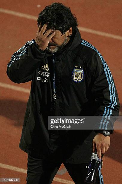 Argentina's head coach Diego Maradona wipes his face as he leaves the pitch after a during a team training session on June 23 2010 in Pretoria South...