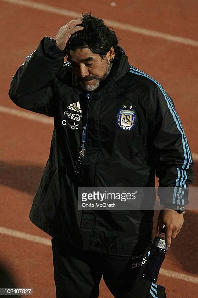 Argentina's head coach Diego Maradona wipes his face as he leaves the pitch after a during a team training session on June 23, 2010 in Pretoria,...