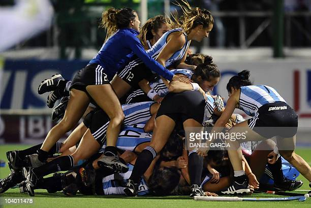 Argentina's hockey players celebrate after defeating Netherlands 31 in the field hockey final match for the Women World Cup 2010 in Rosario Argentina...
