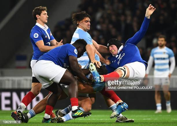 Argentina's hooker Agustin Creevy and Argentina's flanker Pablo Matera vie for the ball with France's scrumhalf Baptiste Serin France's prop Cedate...
