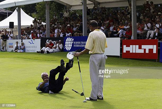 Argentina's Horacio Carbonetti falls to the ground with delight as he wins the playoff against England's Denis Durnian during the final round of the...