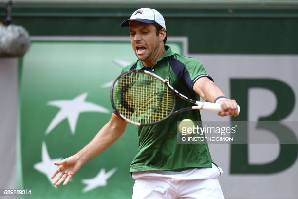 Argentina's Horacio Zeballos hits a return to France's Adrian Mannarino during their qualification round match at the Roland Garros 2017 French...