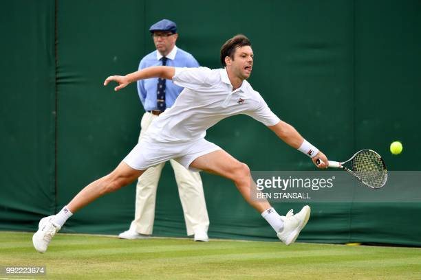 TOPSHOT Argentina's Horacio Zeballos returns against Serbia's Novak Djokovic during their men's singles second round match on the fourth day of the...