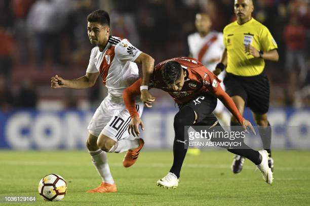 Argentina's Independiente defender Alan Franco vies for the ball with Argentina's River Plate midfielder Gonzalo Martinez during a Copa Libertadores...
